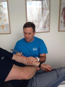 Alan Rankin treating a patient